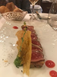 Marinated beef with juniper berries and tarragon, emulsion of tuna with caper berries
